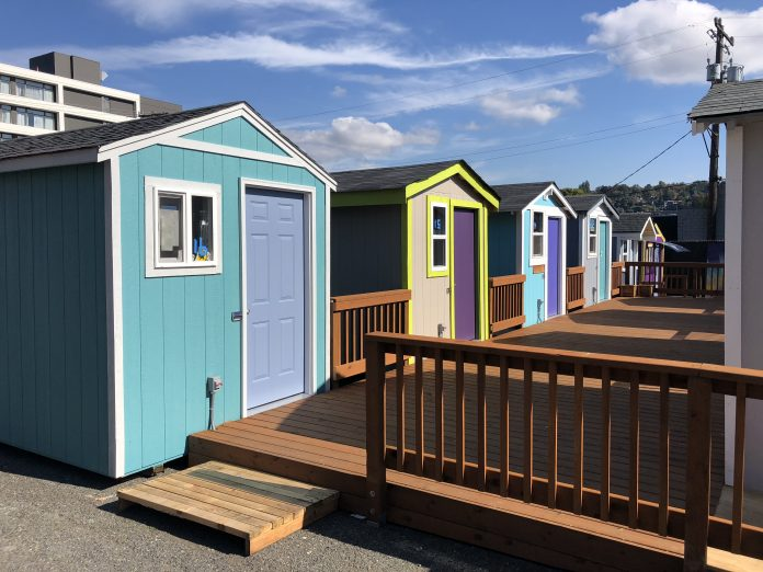 Six tiny houses with a common deck, Lake Union Village