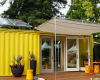 Small yellow shipping container house