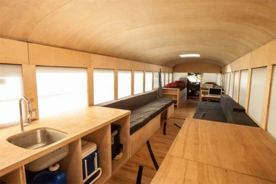 Interior view of school bus converted into a home